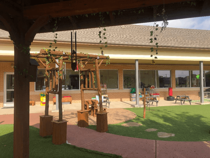 Wooden-Canopies-draped-with-flowers-in-alpha-montessori-school-plano
